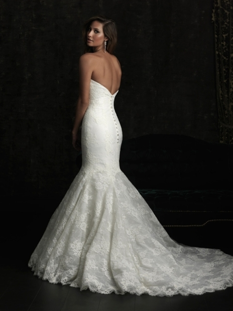 model wearing Allure Bridal 8970 mermaid lace dress with low back and chapel train
